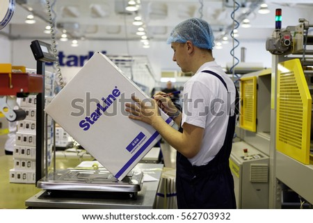 ST. PETERSBURG, RUSSIA - NOVEMBER 2, 2016: People at work in the department of packaging of products of StarLine company. It is one of the leading company on the automotive security market of Russia #562703932