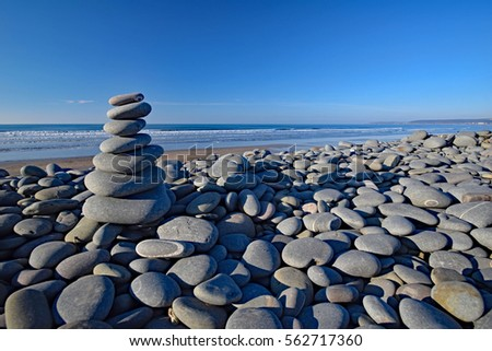 Balanced stones on the Pebble Ridge at Westward Ho! in North Devon, England Royalty-Free Stock Photo #562717360