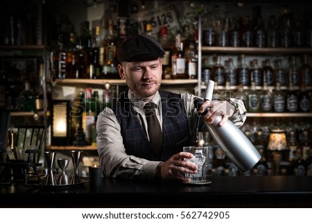 Bartender  is pouring a drink #562742905