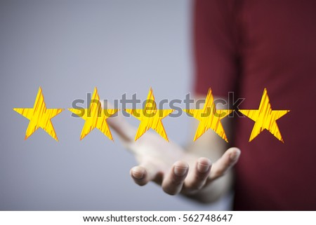 View of a Businessman touching technology interface with ranking stars #562748647
