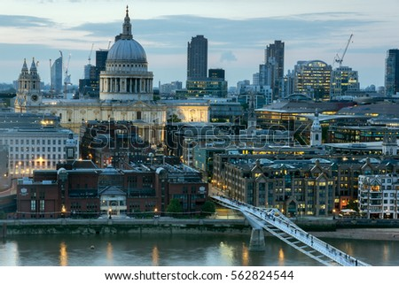 LONDON, ENGLAND - JUNE 18 2016: Night photo of Millennium Bridge, Thames River and  St. Paul Cathedral, London, Great Britain #562824544