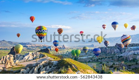 The great tourist attraction of Cappadocia - balloon flight. Cappadocia is known around the world as one of the best places to fly with hot air balloons. Goreme, Cappadocia, Turkey Royalty-Free Stock Photo #562843438