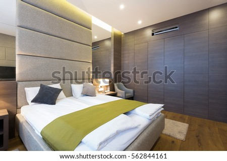 Interior of a bedroom in a new hotel  #562844161