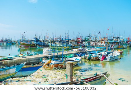 MIRISSA, SRI LANKA - DECEMBER 3, 2016: The fisheries harbor is the main landmark of the small coastal town, on December 3 in Mirissa. #563100832