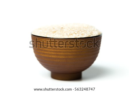 A bowl of rice isolated over white background #563248747