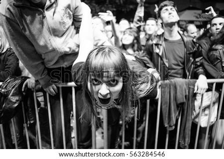 Kragujevac, Arsenal Fest - July 27th: Girl enjoying during performance of Serbian rock band Babe on Arsenal Fest 2013 held in Kragujevac, Serbia #563284546