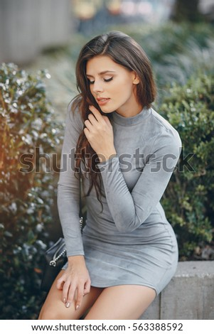 beautiful girl posing in a park on a sunny day #563388592