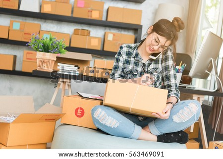 Young entrepreneur, teenager business owner work at home, alpha generation life style. phone call receive from customer and white down address for deliver #563469091