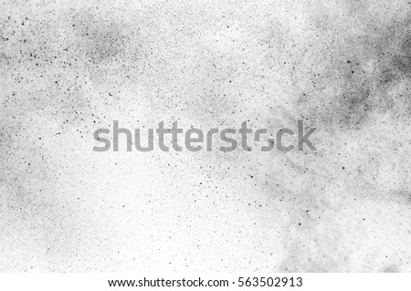 Black particles explosion isolated on white background.  Abstract dust overlay texture. Royalty-Free Stock Photo #563502913