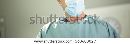 "Surgeon in hospital surgery in sterile uniform ""scrubs"" and mask in operating theater emergency room in surgical operation. #563603029"