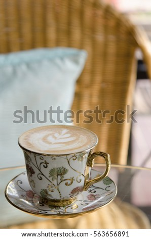 A Cup of hot latte art coffee on  table #563656891