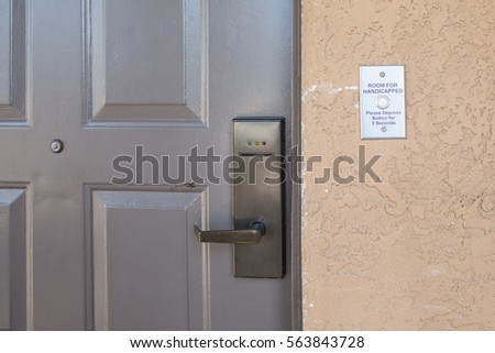 room for handicapped with handicapped button system to open the room and security system #563843728