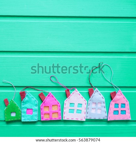 Spring background with houses over green wooden background