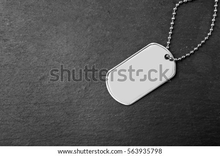 Military ID tag on dark background