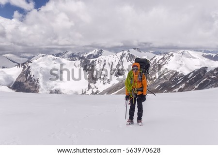 climber on a glacier with equipment with a rope in the mountains #563970628