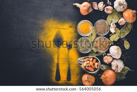 Ground colorful Indian spices and herbs. On the black chalkboard. #564005056