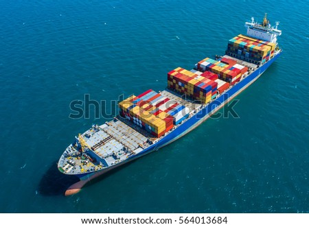 container,container ship in import export and business logistic.By crane ,Trade Port , Shipping.cargo to harbor.Aerial view.Top view. #564013684