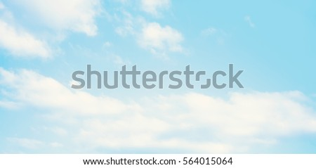 Blue sky in the soft white clouds. Natural cloudscape background, texture. Wide Horizontal Wallpaper With Copy Space