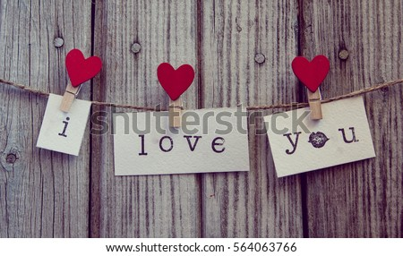 inscription i  love you on white paper hanging on a rope with clothespin