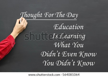 Thought For The Day message of Education Is Learning What You Didn't Even Know You Didn't Know written on a School Blackboard by the teacher. #564081064