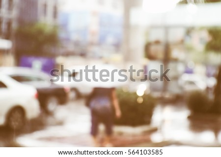 Blurred  background abstract and can be illustration to article of People walking on the rain #564103585