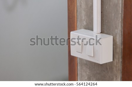 The switch on the wall #564124264
