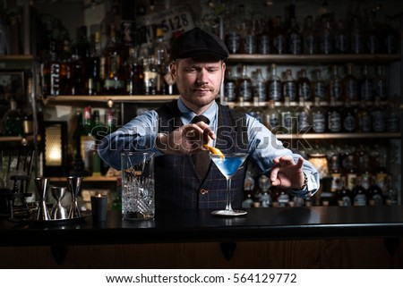 Bartender is decorating a drink #564129772