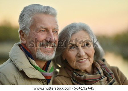 Happy senior couple  near river #564132445