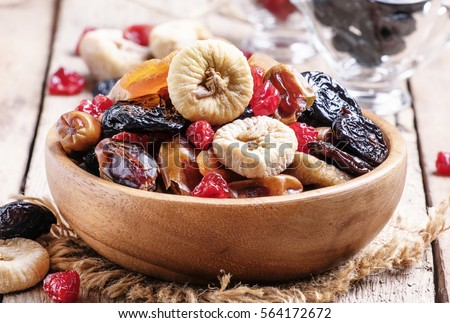 Healthy food: mix from dried fruits in bowl, old wooden background, selective focus Royalty-Free Stock Photo #564172672