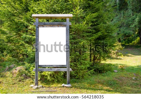 White blank sign board in the green park