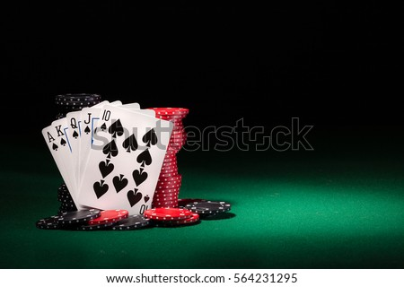 winning hands of cards.  gambling success and room in frame for text. Royalty-Free Stock Photo #564231295