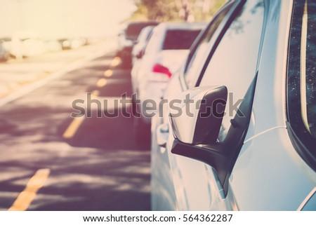 car parking on roadside. vintage filter #564362287