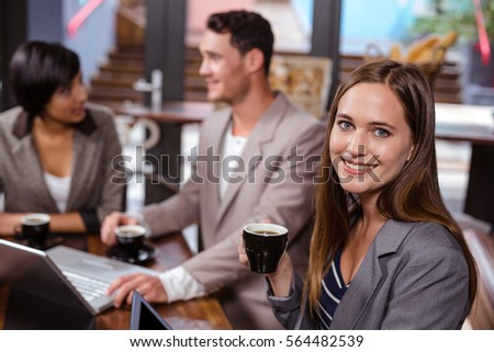 Friends drinking coffee while talking #564482539