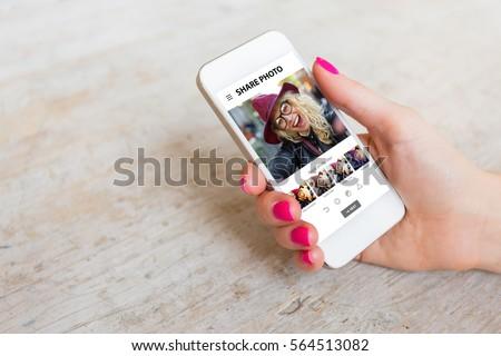 Woman using photo sharing app on phone