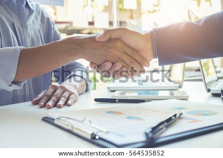 Business handshake and business people.Vintage tone Retro filter effect,soft focus,low light. Royalty-Free Stock Photo #564535852