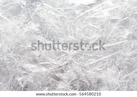 Background of ice crystals on water surface. Close up. Selective focus.