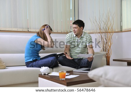 young couple at home with  modern livingroom indoor working on laptop on house finance and planing #56478646