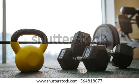 Photo of sport equipment in gym. Dumbbells on floor. Royalty-Free Stock Photo #564818077