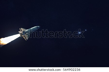 Space shuttle orbiting Earth planet. Elements of this image furnished by NASA #564902236
