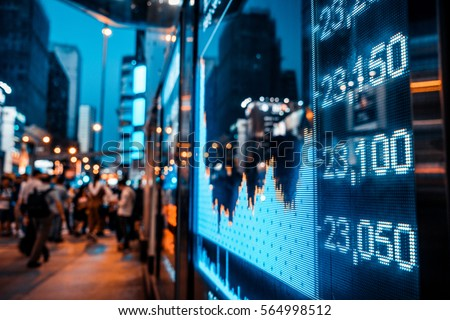Display of Stock market quotes with city scene reflect on glass Royalty-Free Stock Photo #564998512