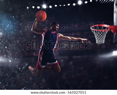 Basket player throws the ball at the stadium #565027051