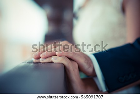 Hand in hand, the man's hand holding the girl's hand #565091707