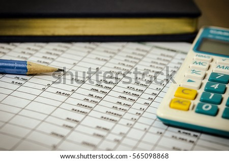 Financial data table and calculator on desk.vintage filter #565098868