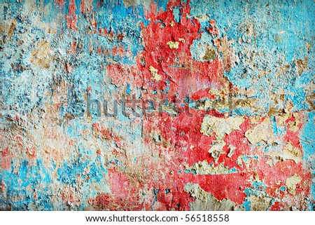 Weather-beaten paint different colors on the old wall #56518558