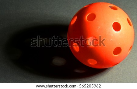 Perforated red ball and its shadow #565205962