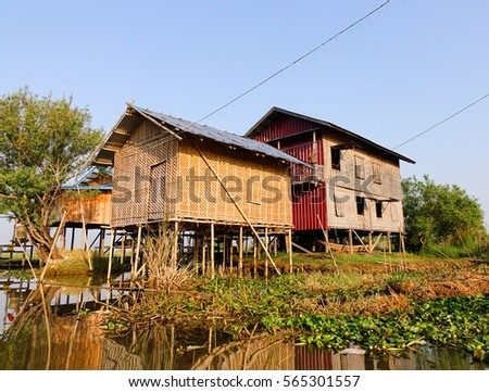 Traditional wooden stilt houses at the Inle lake, Shan state, Myanmar. Inle is one of the highest lakes at an elevation of 2,900 feet (880m). #565301557