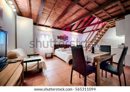 KOMIZA (VIS), CROATIA - AUG 15, 2015: - Traditional old Dalmatian house will charm you with its modern interior design made of stone and wood. #565311094