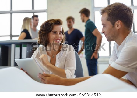 Male and female colleagues discuss business while working on laptop at morning meeting #565316512
