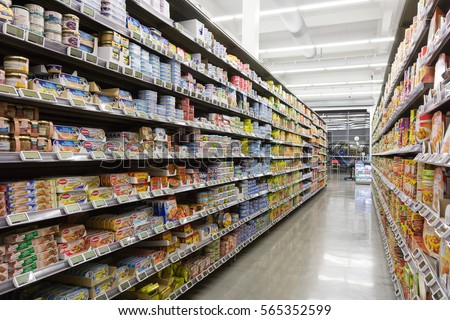 Valenciennes, France, 2017/01/03. Shelves with food products like cans in grocery store. #565352599