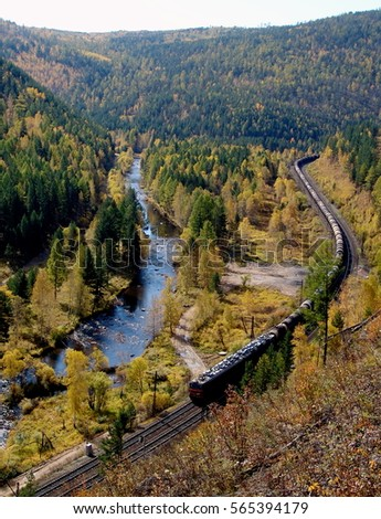 The TRANS-Siberian railway at the river Olkha in the Baikal region Royalty-Free Stock Photo #565394179